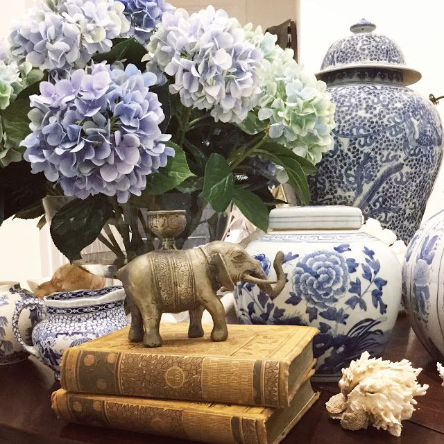 British Colonial decor - blue & white pottery, flowers and old books.  Love the little elephant!