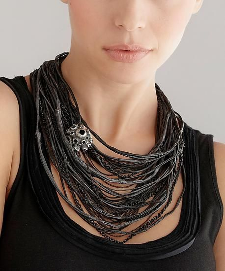 """""""Layers Series Rubber Necklace""""  Monique Rancourt This necklace is constructed of brass chain that is dipped in rubber then fabricated in to a sterling clasp."""