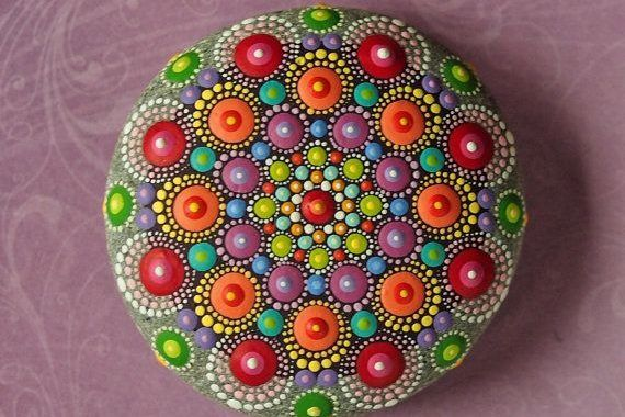 "50 Mandala Rock Painting is part of Mandala rocks, Painted rocks, Stone painting, Jewel drop mandala, Rock art, Stone art - Mandala actually is a sacred pactice enganged by Tibetan monks and many other cultures  Mandala words originated from classical Indian Sanskrit languange that could be losely means a ""circle""  Here is DIY Mandala Rock Painting   How to Make It"