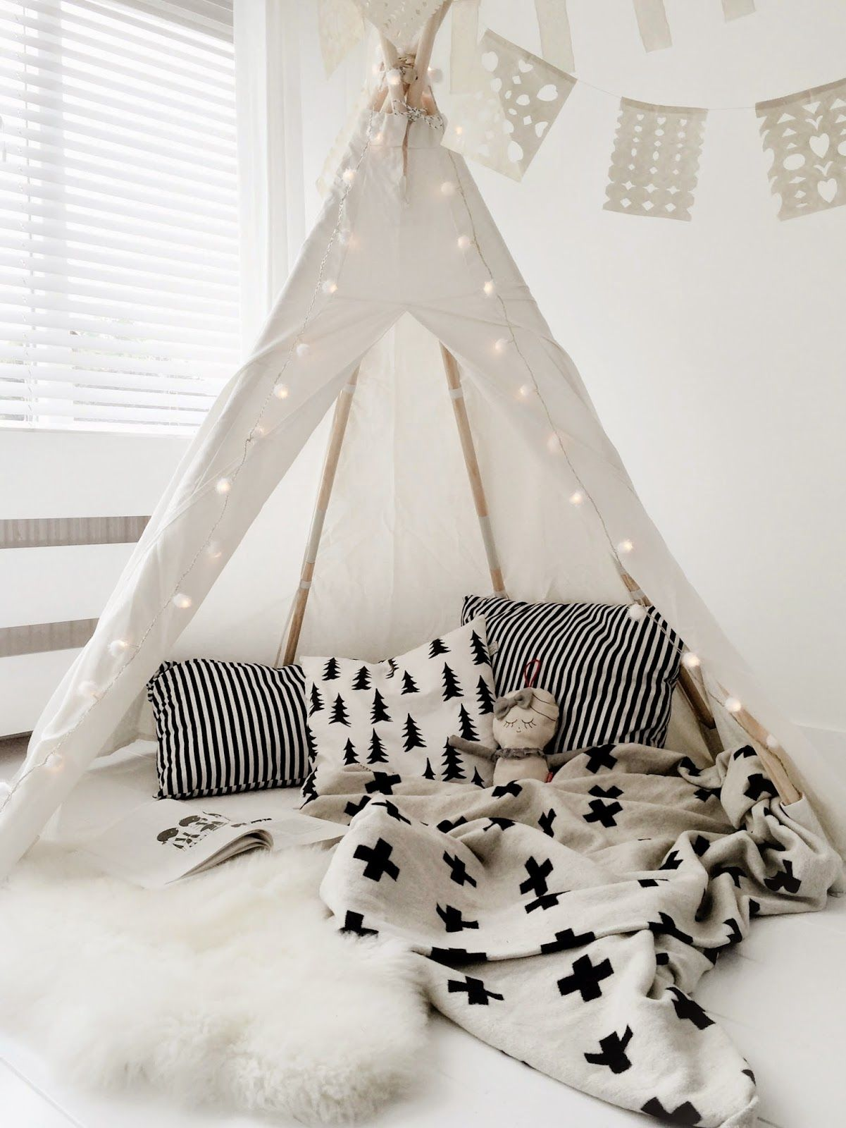 Proof that black & white doesn't have to look cold .... cool monochrome accessories on a white backdrop make this one very stylish teepee :: KOKO KIDS :: #teepee #black&whitechildrensrooms #monochromenursery