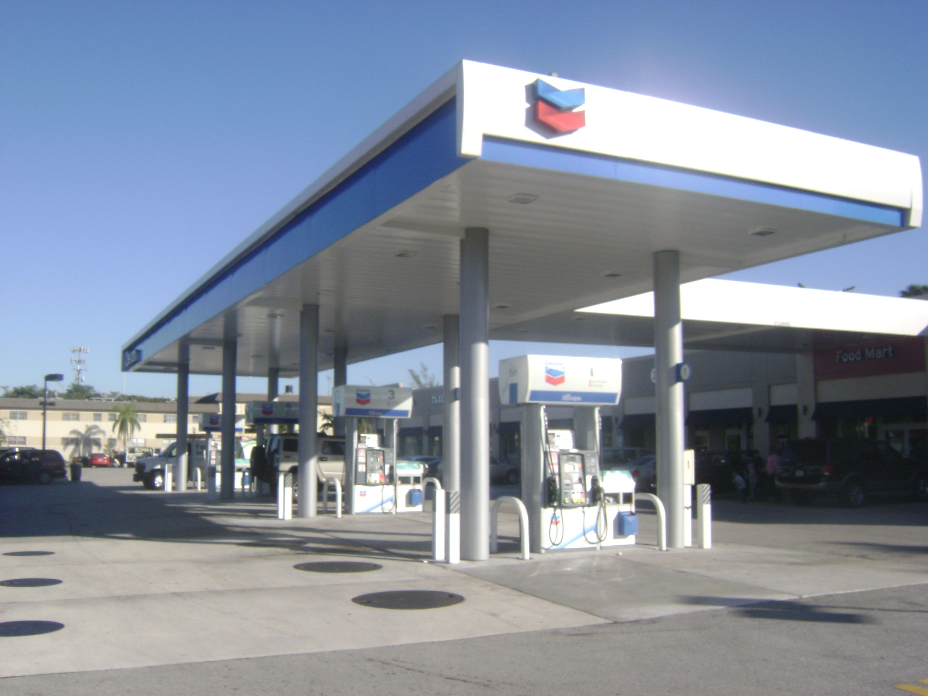 A chevron petrol station in the day there is also a food