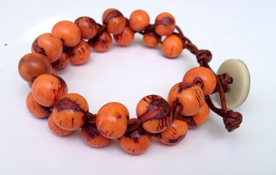 This bracelet is made from bright burnt orange beads. Its difficult to capture the beautiful vivid orange these beads have in photographs!