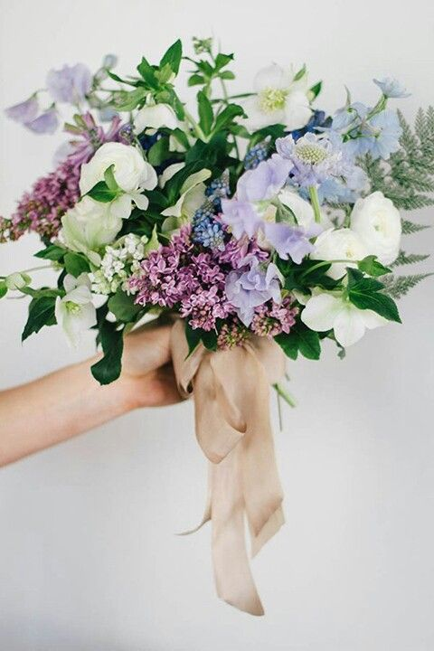 Gorgeous Wedding Bouquet Featuring White Ranunculus Hellebores Lilacs Lavender Sweet Pea