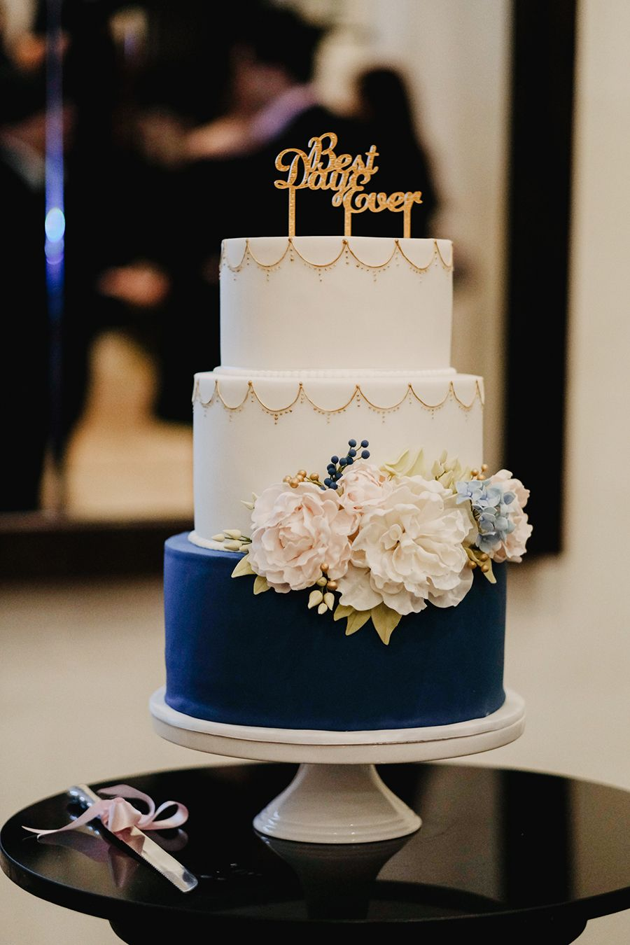 Beautiful Three Tiered Wedding Cake In White And Navy Blue With Gorgeous Fl Bloom