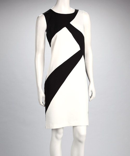 Eye catching shapes and a classic silhouette—that's a winning match! Be seen in this formfitting color blocked dress.Measurements (size 8): 38'' long from high point of shoulder to hem88% polyester / 9% rayon / 3% spandexMachine wash; tumble dryImported
