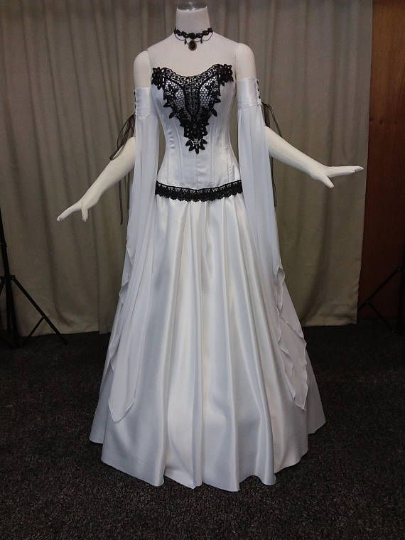 bd18c4834a4b Gorgeous black and white gothic wedding dress. This gown is in 3 parts. The  skirt is constructed from white duchess satin. The corset is white duchess  satin ...