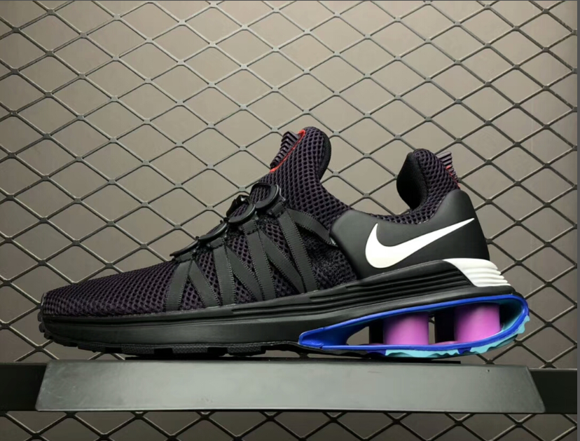 919c84062d5e This Nike Shox Gravity Grand Purple men s casual shoes feature a Black and  Purple knitted upper paired with Purple and Blue tones at the heel.