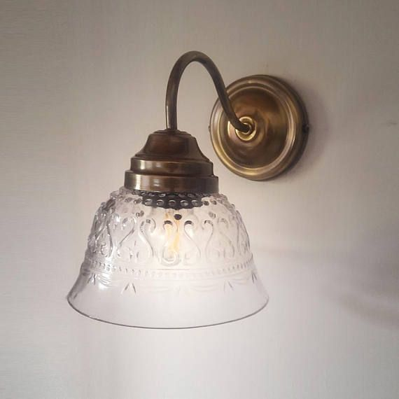 Dark oxidized solid brass wall mounted lighting fixture with and a dark oxidized solid brass wall mounted lighting fixture with and a retro antique style glass shade aloadofball Images