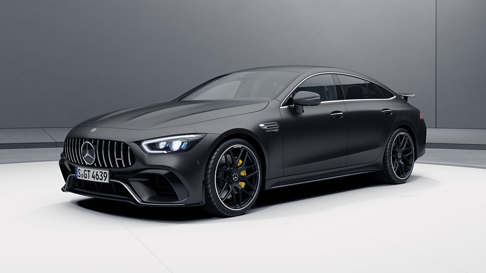 The Mercedes Amg Gt 4 Door Coupe Now Offered With Aero Kit Top Speed Mercedes Amg Black Mercedes Benz Mercedes Benz Amg