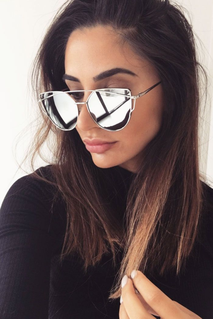 ec4afaaf8c0 The Reflector Sunglasses feature silver mirror lenses with an oversized