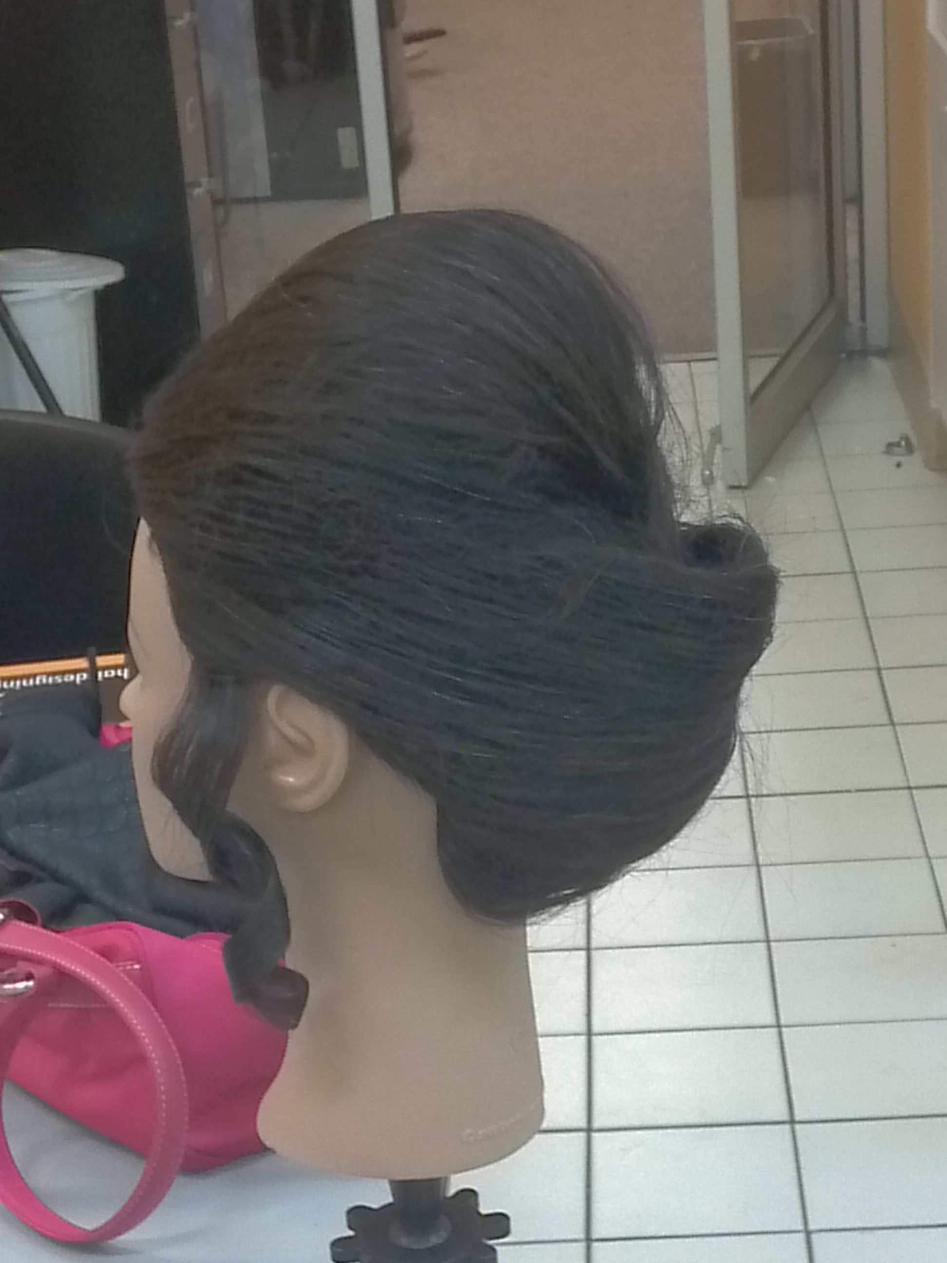 Teased updo with single curl