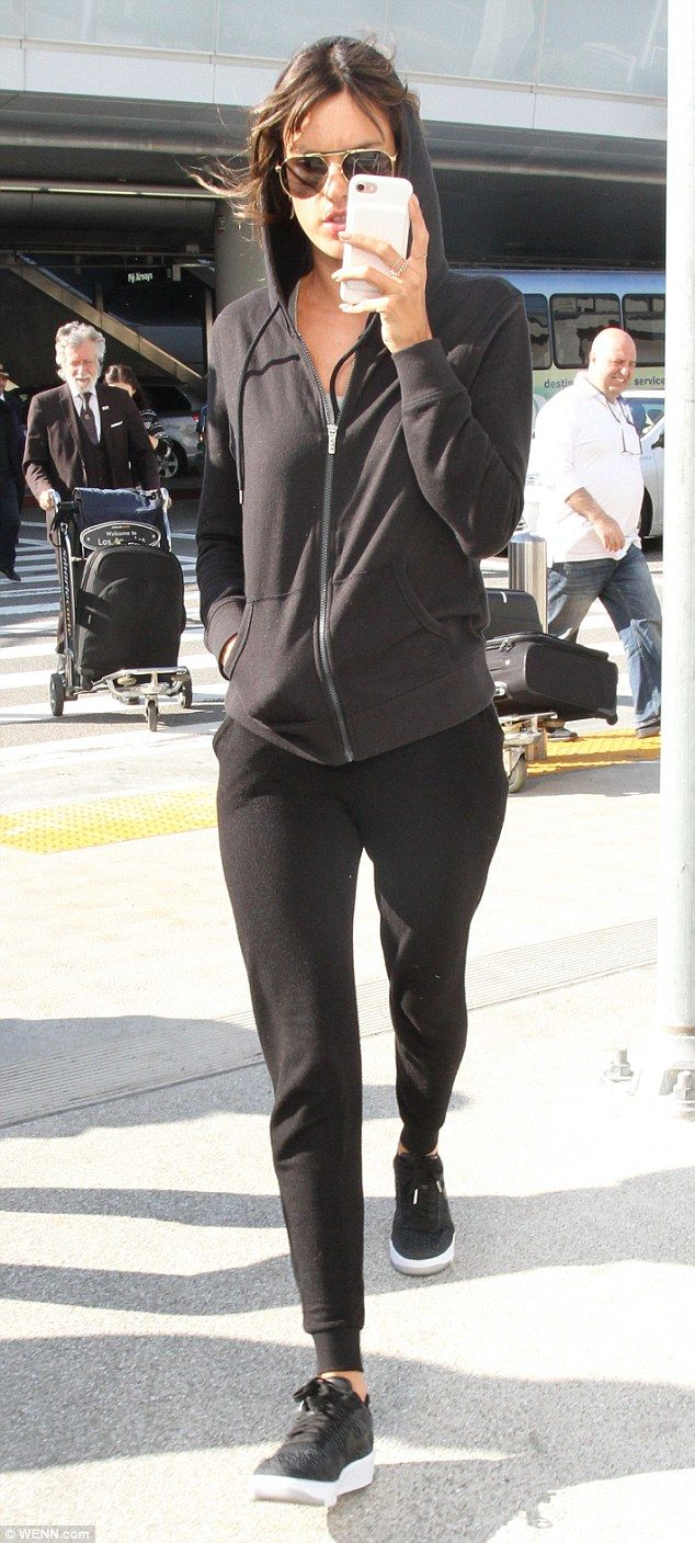 Camera shy: After jetting back to LA from Paris Fashion Week, Alessandra Ambrosio tried he...