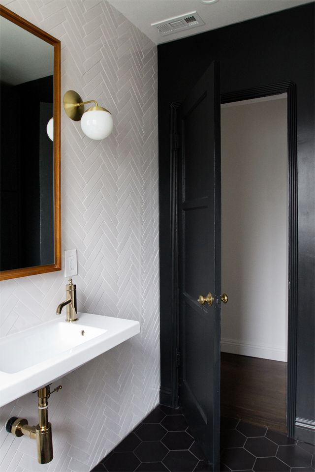 Bathroom renovation herringbone tile brass fixtures for Small bathroom herringbone tile