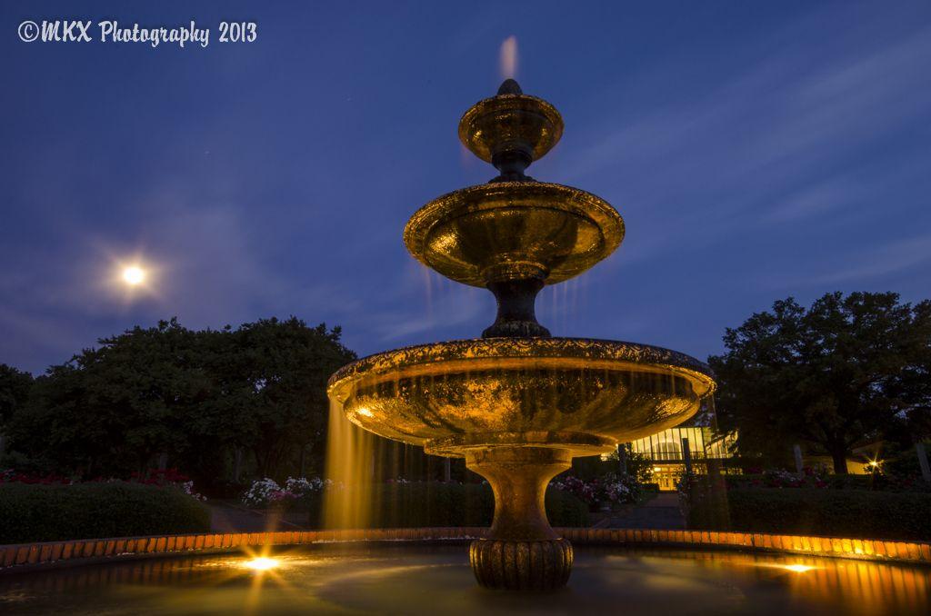 A close-up of the rose garden fountain in the Memphis Botanic Gardens.