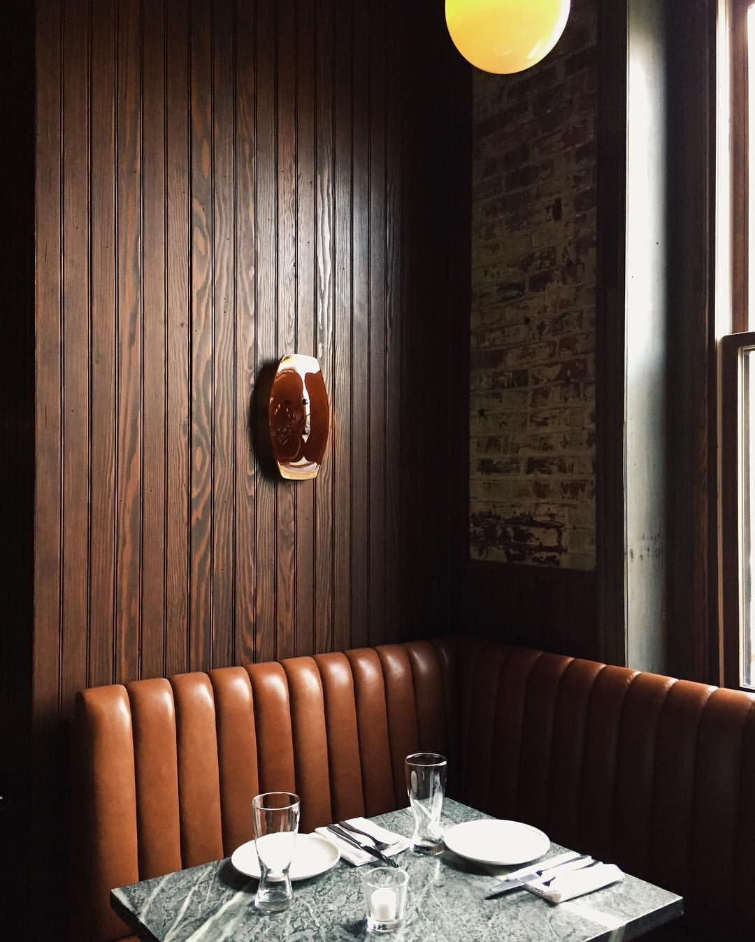 Leather banquette and beadboard restaurant booth seating