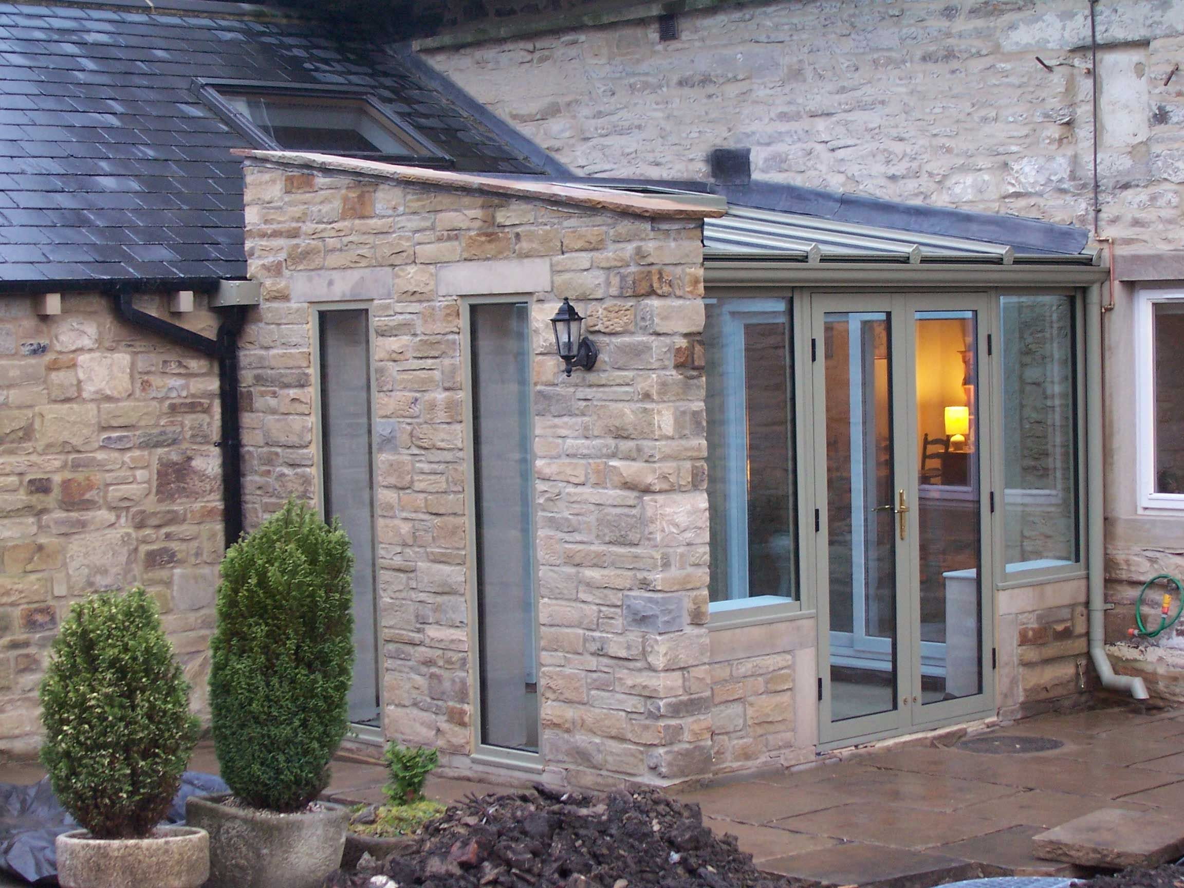 House Entrance With Stone Cladding Benefits Of Your Bespoke Conservatory