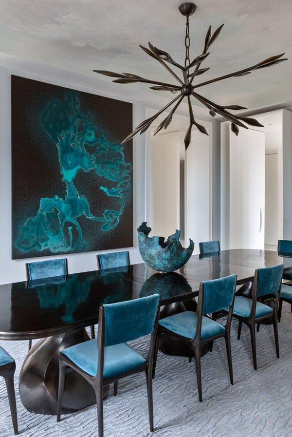Dining Room Drama  Glossy black dining table blue velvet chairs sculptural chandelier