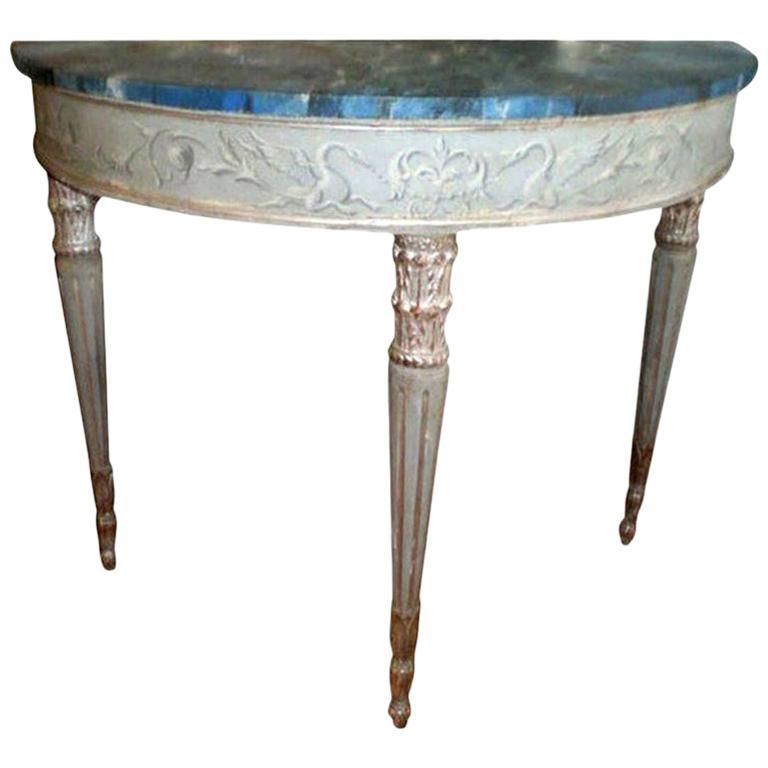 Lovely freestanding 19th century neoclassical style Italian hand painted and silver gilt console table, demilune or sofa table with faux marble top. This stunning Italian painted and silver leaf console table is versatile enough to work in a variety of interiors.