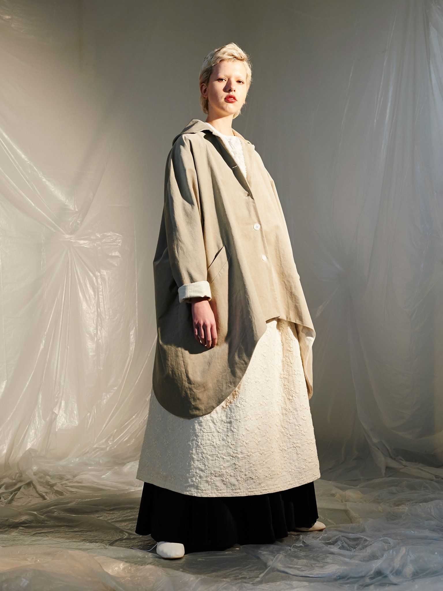 93dcf8556f86 The Chinese designer makes embroidered pieces in cream and beige colors and  big…