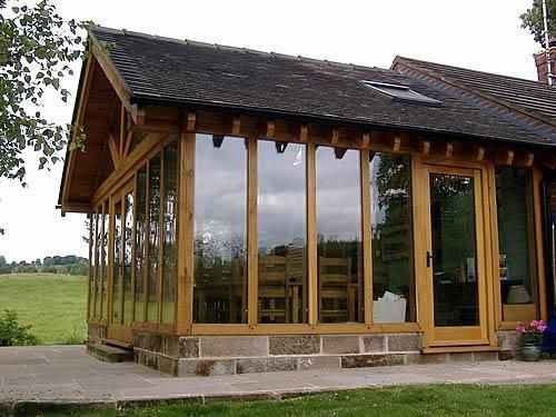 Hand made wood windows and wood conservatories for Timber frame sunroom addition