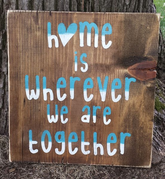 """This adorable 12"""" x 12"""" sign has the perfect description of what """"home"""" really is. A dark stained background with gradient turquoise and white writing. Consid"""