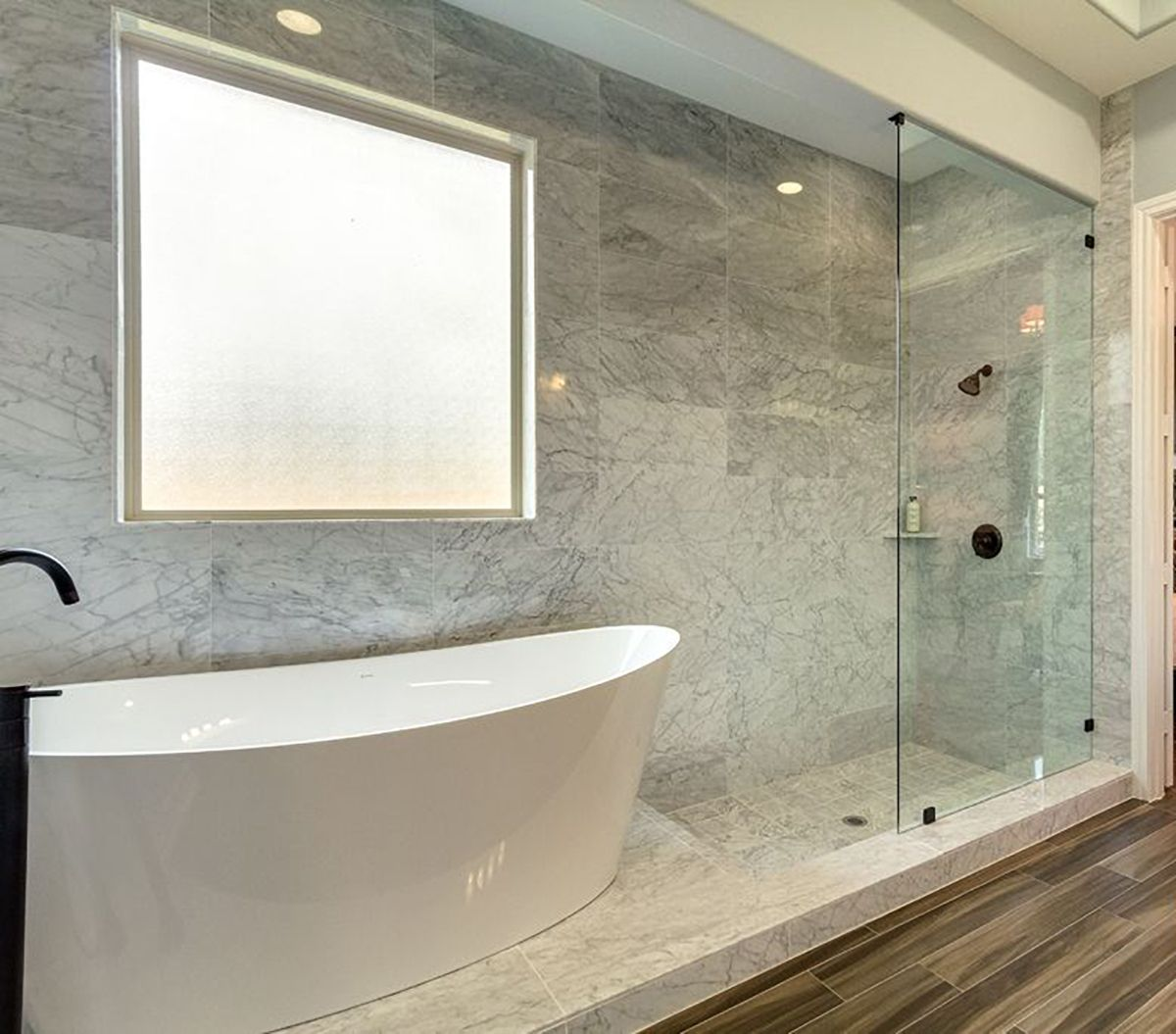 High Quality Master Bathroom Design That Allows Your Freestanding Bathub To Flow  Directly Into A Frameless Shower.