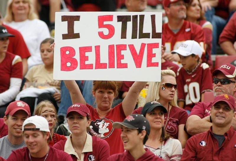 A Florida State fan holds up a sign in support of