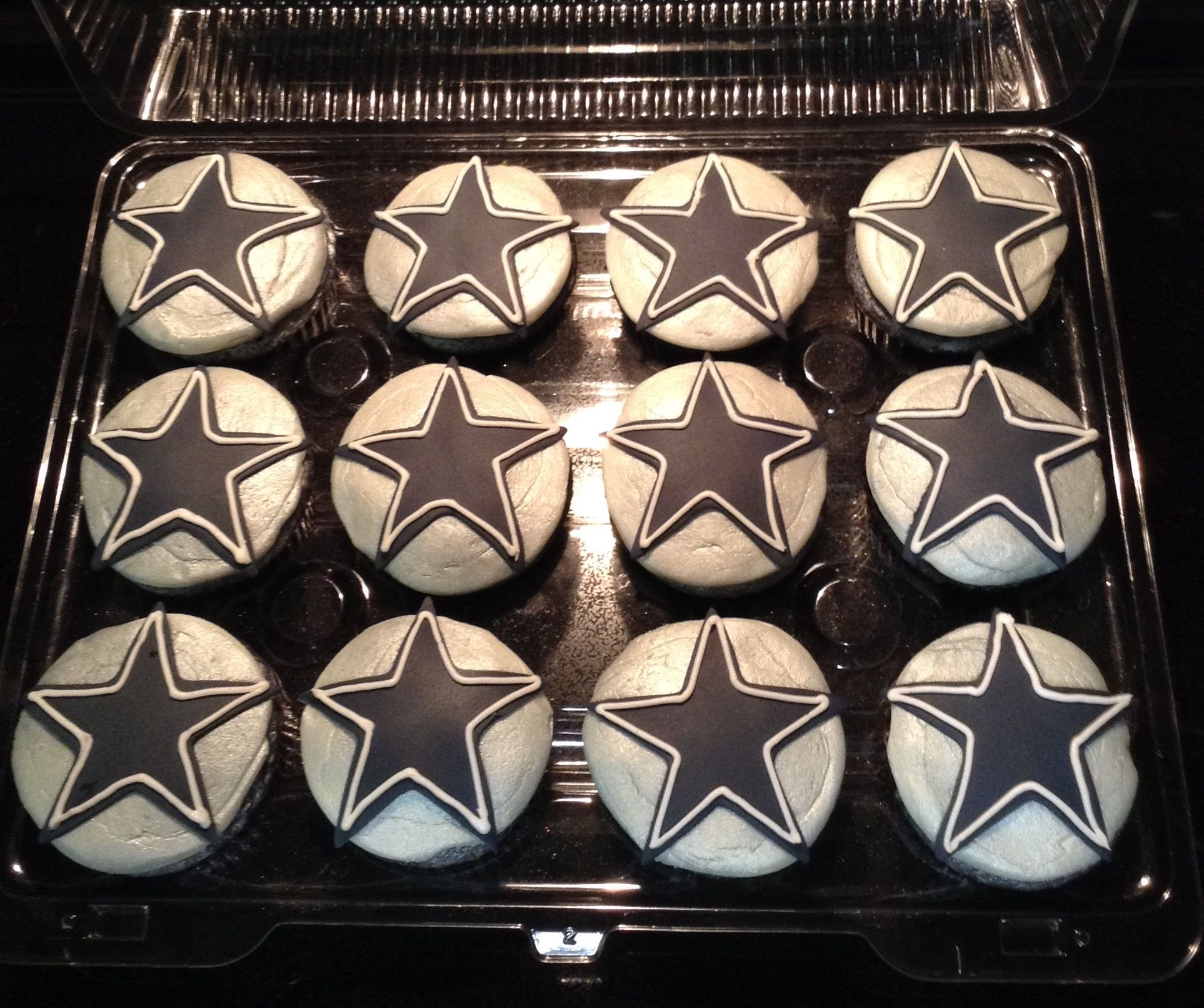 Dallas Cowboy Star cupcakes.  Used Wilton silver color mist and sprayed it directly on the white icing.  (2-16-17)