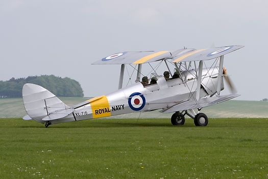 The de Havilland DH82A Tiger Moth G-AOIL / XL715 in a Royal Navy scheme at the Pooley's Day fly-in, Compton Abbas