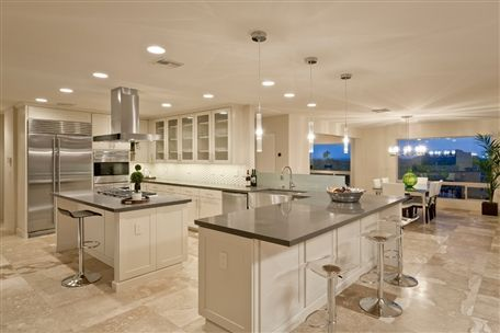 Great contrast with a black granite counter-top and beige marble ...
