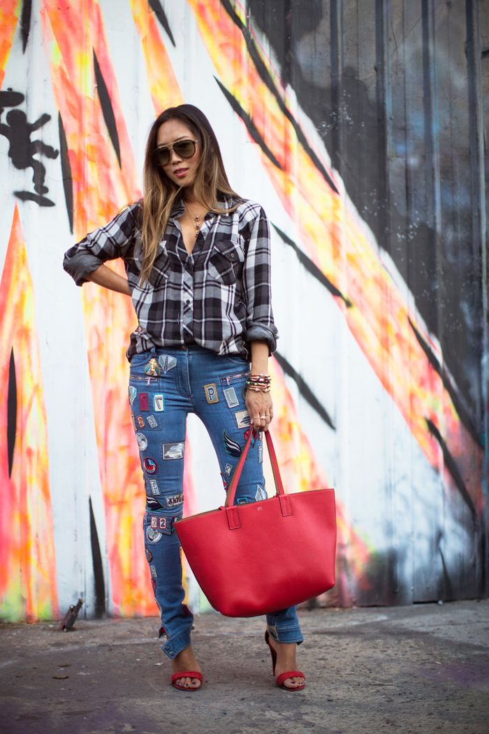 patched jeans and a burst of red song of style denim co