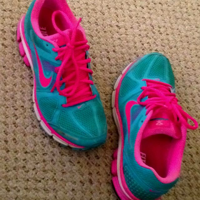 Neon pink and blue Nike running shoes