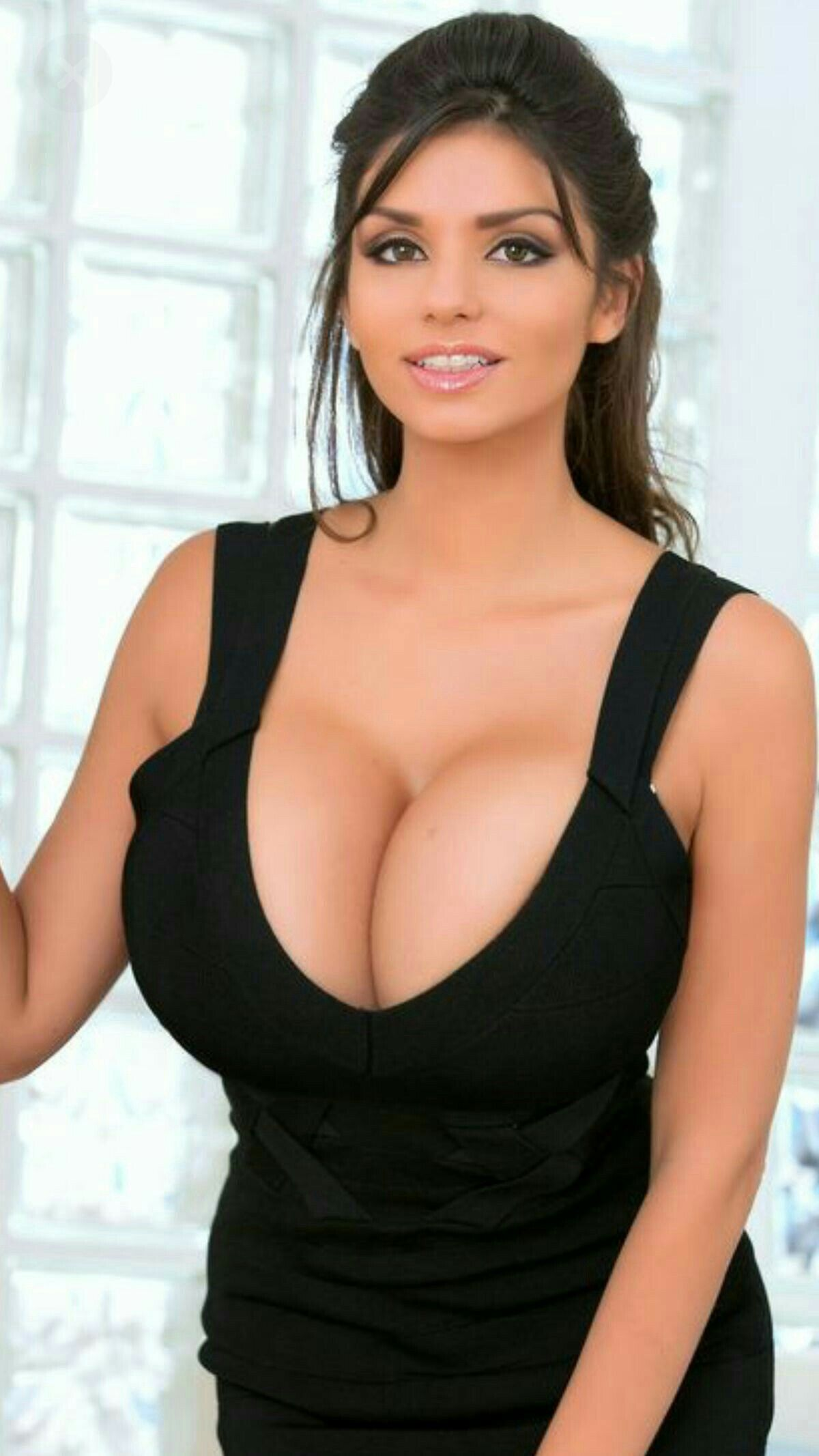 Huge Boobs low cut black dress