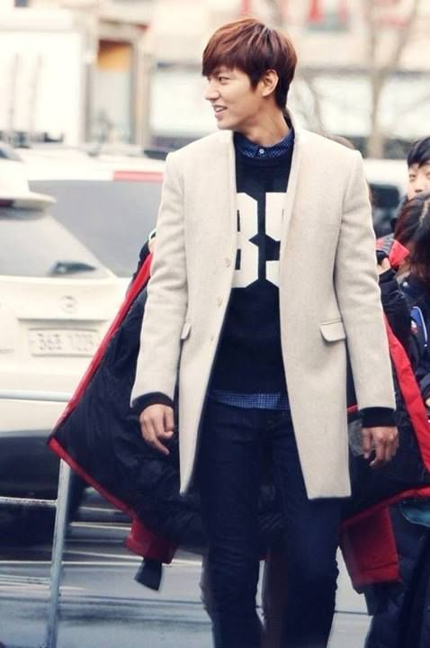 Lee min Ho in white, long and collarless overcoat, over an athletic sweatshirt (no hood) over chambray button down
