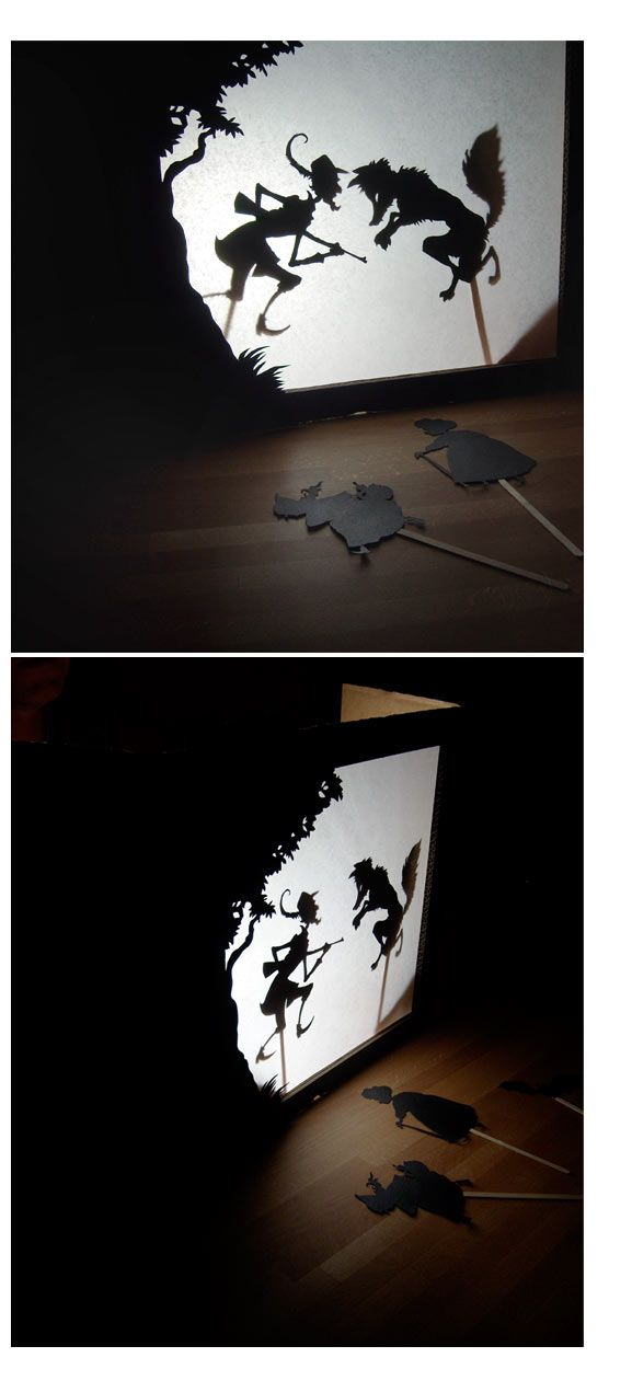 European-style shadow puppets in a shadow theatre made from an old