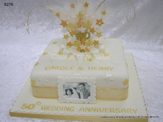 Ivory Wedding Anniversary Cake With Gold And Stars Lback Top To Reveal A Starburst Topper Containing Feathers Glitter Bead Spray
