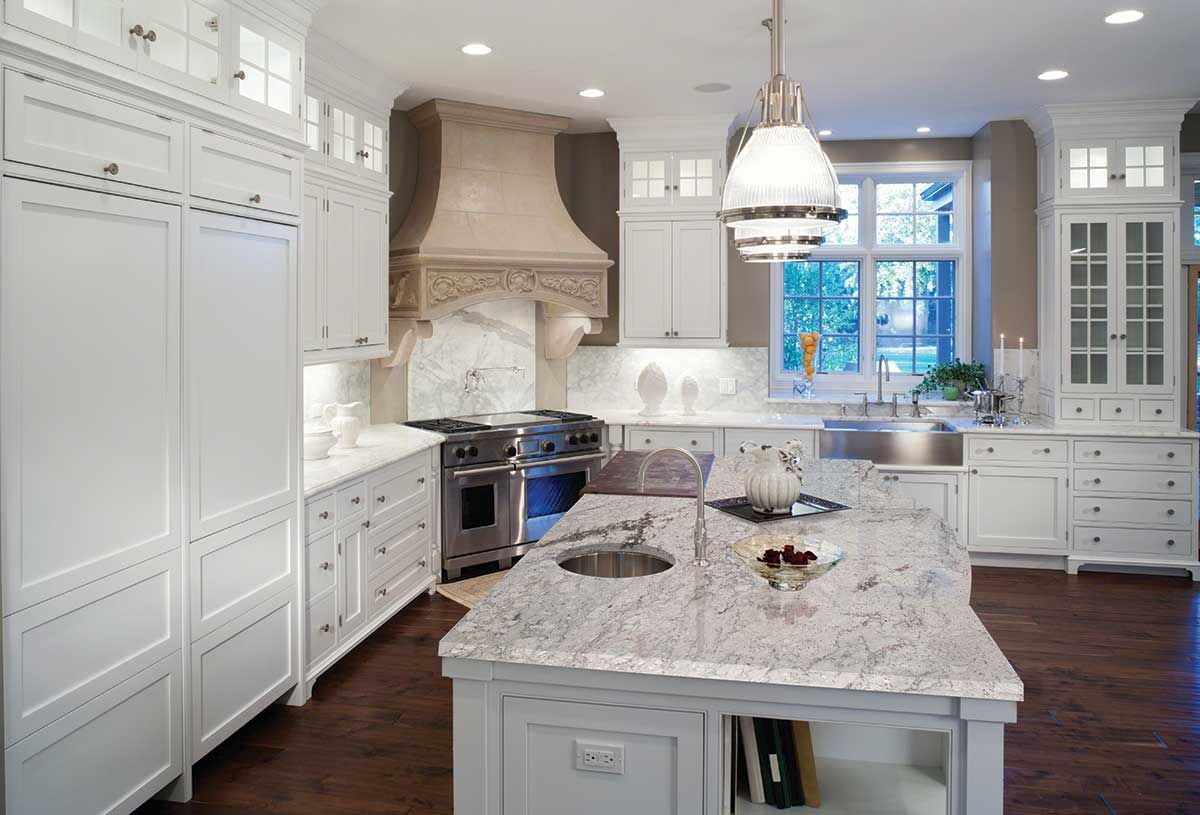 Granite Kitchen Countertops With White Cabinets Thunder White Granite Pairs Well With The Pendant Lighting And