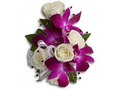Fancy Orchids and Roses Wristlet :  Fabulous fuchsia and white blooms with the subtle sparkle of rhinestones. A fantastic contrast of purple dendrobium orchids with white spray roses on a pearl wristlet. For more details visit ..  http://www.dreamflowershouston.com/product/fancy-orchids-and-roses-wristlet-120