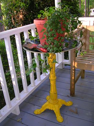 Make a metal table/plant stand... glue (liquid nails) some wood to ...