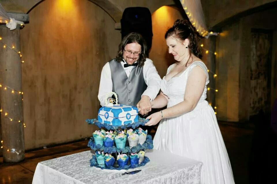 Us cutting our cake. Yes it is a companion cube in our colour scheme :)