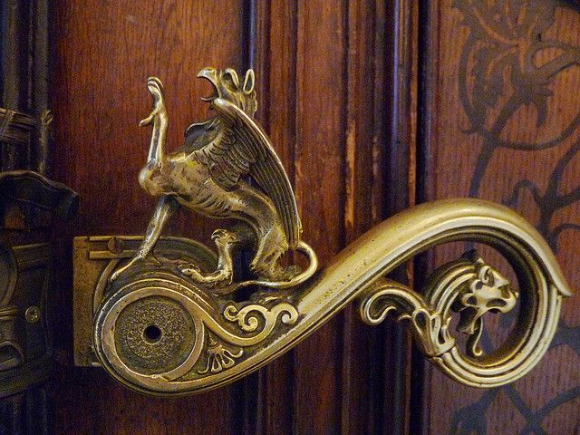 Mythical griffin door handle which leads to the bathroom at a military museum. & Elaborate griffin gryphon door handle | What Is This Place ...