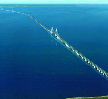 Hangzhou Bay Bridge (China): World's Longest Trans-Oceanic Bridge. The longest trans-oceanic bridge in the world extends across the Hangzhou Bay and extends to over 35.673 kilometers (22 miles) in length. It hosts six expressway lanes in two directions. The bridge was constructed with a view to minimize traffic congestion and shorten the driving time between Shanghai and Ningbo.