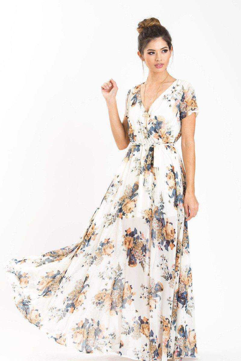 76996ed614 Always say yes to floral maxi dresses! We love this short sleeve chiffon  beauty with a self tie waist and the most elegant flowy skirt!