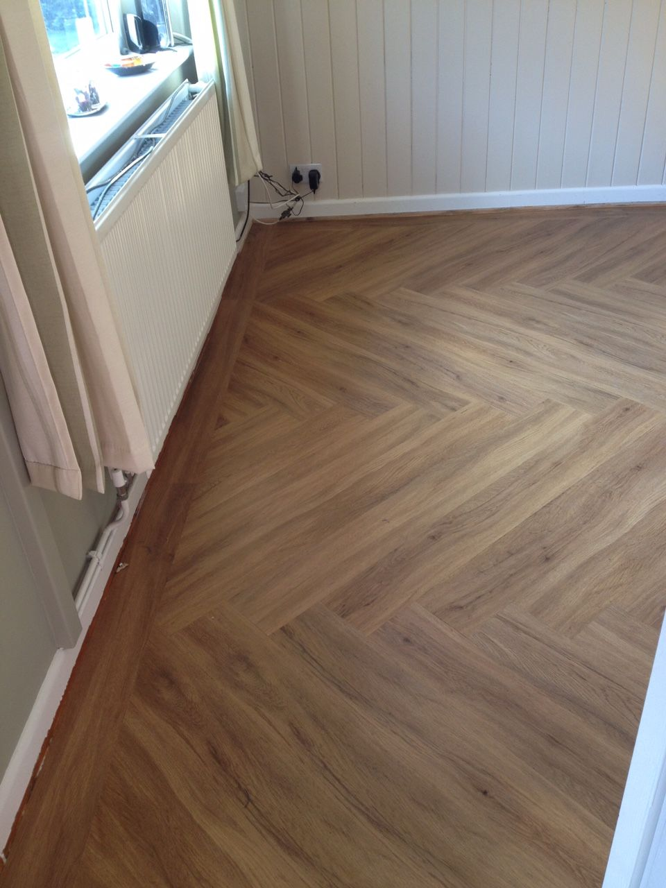 Polyflor Colonia Schoolhouse Oak fitted in a herringbone