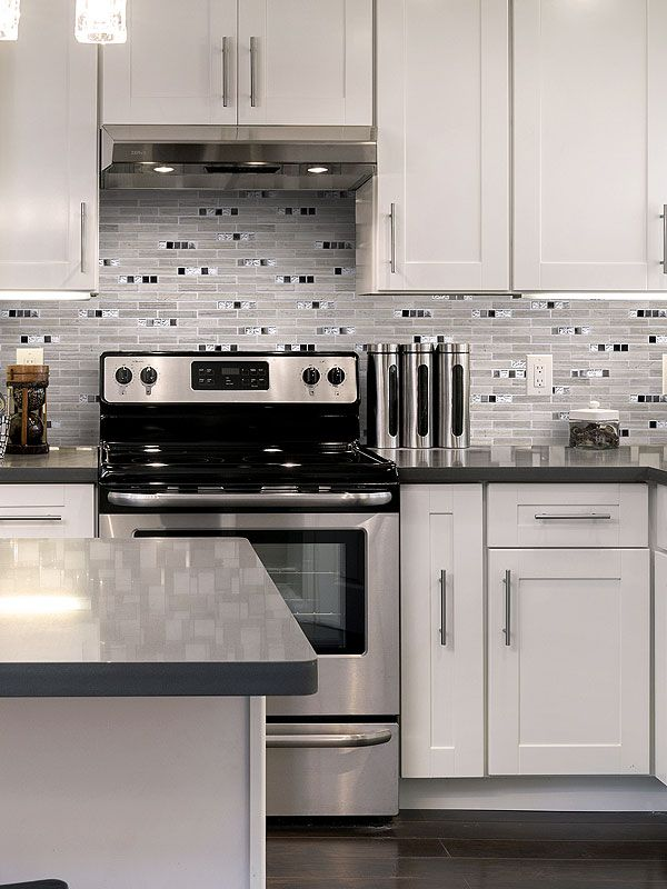 Gray wood looking marble kitchen backsplash tile with glass and ...