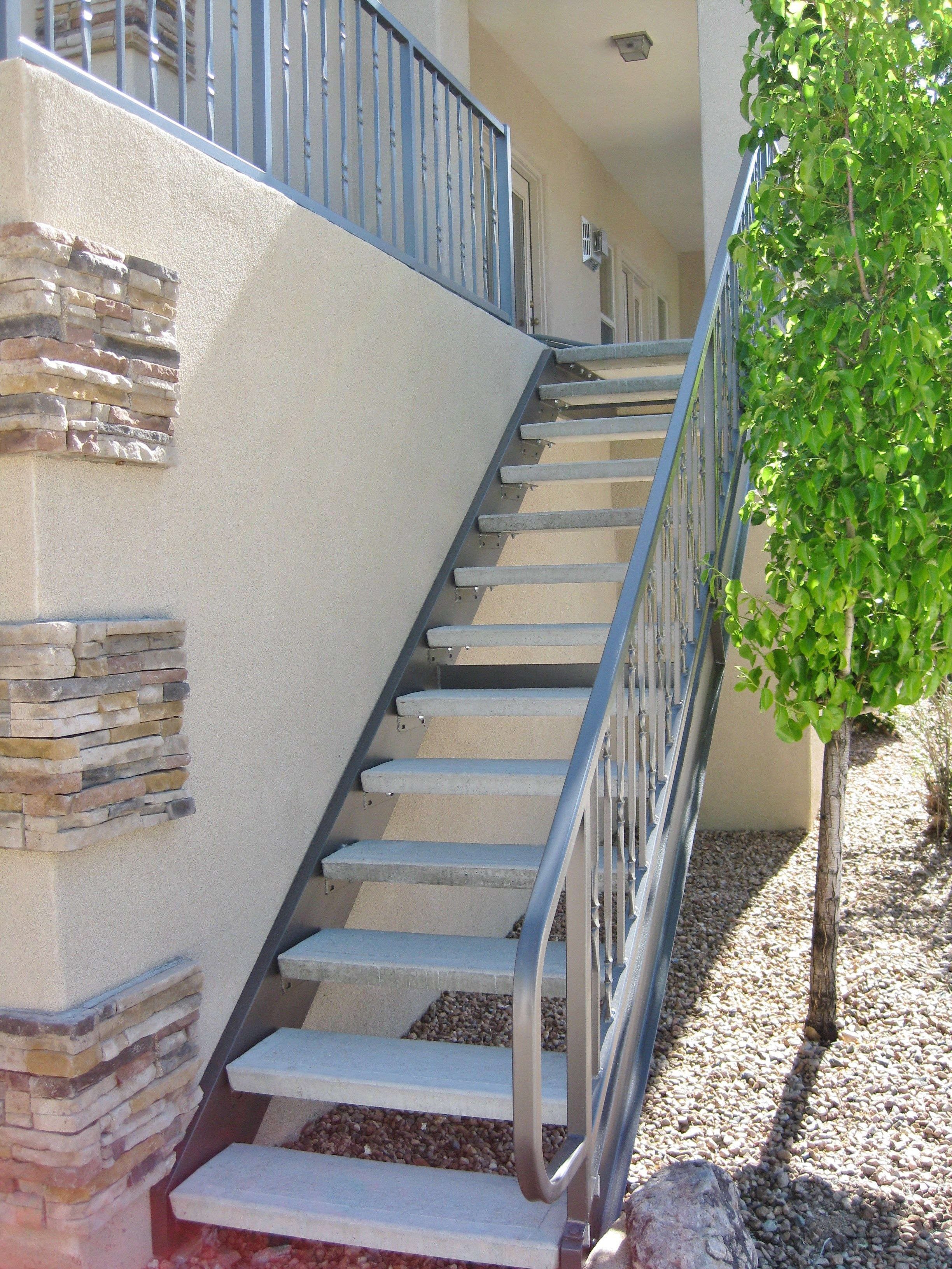 Residential exterior stairs with steel stair and balcony ...