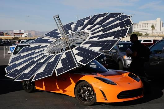A Lotus Mobile solar power system sits on top of a Tesla ...