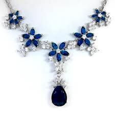 The next white gold line up is the blue sapphire necklace earrings set. Description from uniquejewelrys.com. I searched for this on bing.com/images