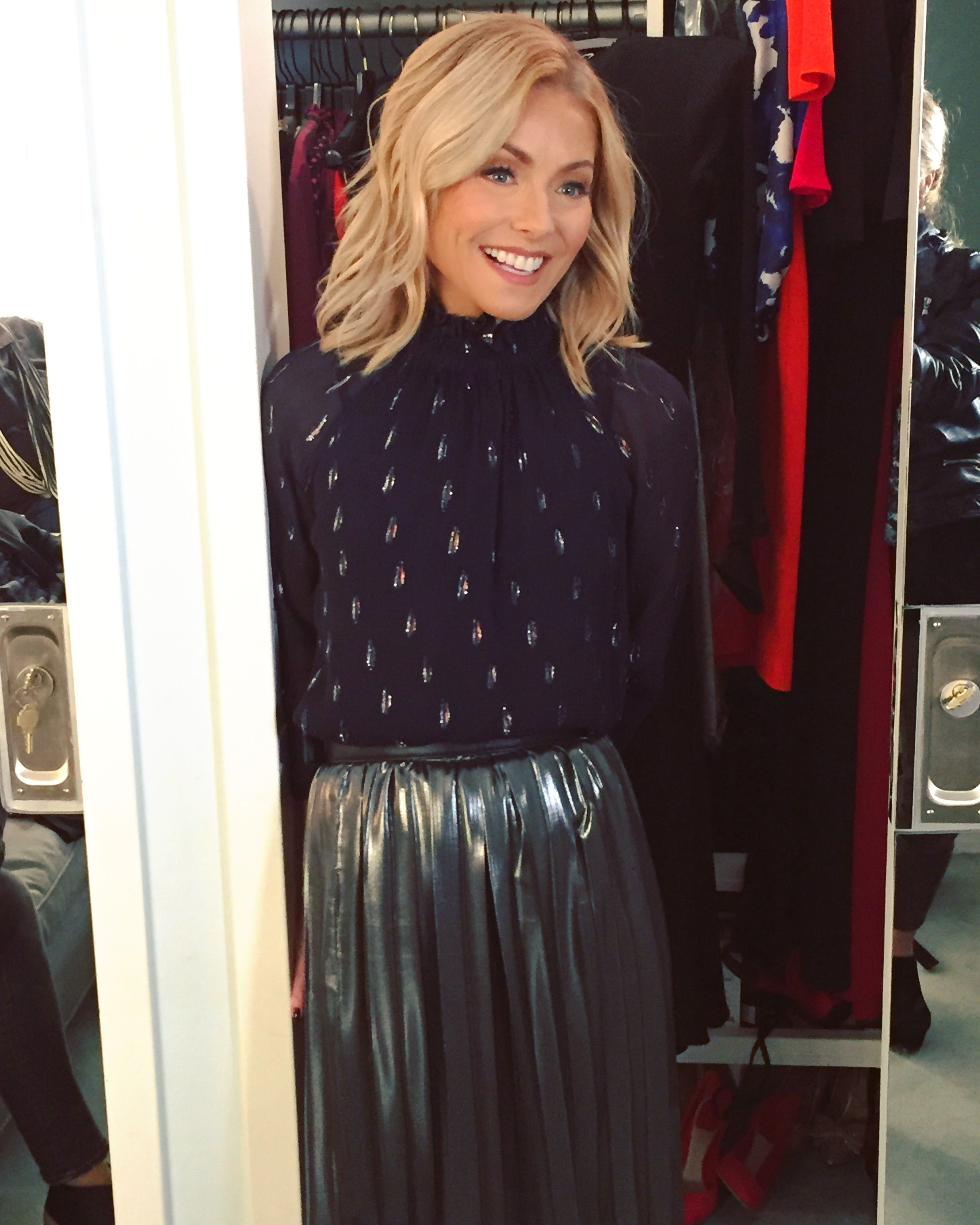 Kelly Ripa in a FRAME top and O2nd skirt from Intermix