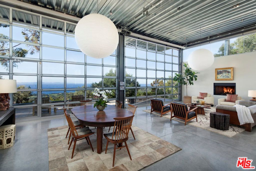 For Sale 6 995 000 Sweeping Ocean Views Are On Full Display From This Sleek Modern Home Designed By Barton Meyers Garage Door Styles Glass Garage Door Home